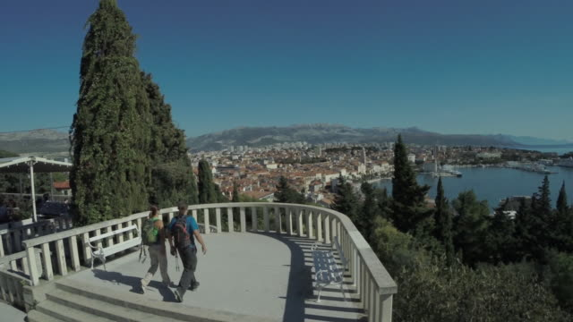 Couple walking on the viewing platform over Old Town of Split