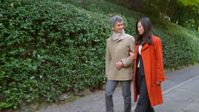 Couple walking outdoors together