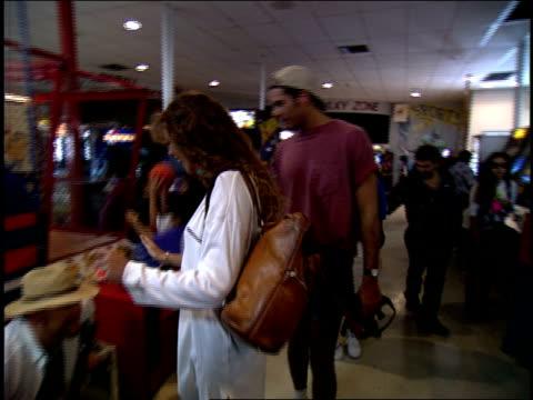 Couple Walking Through an Arcade