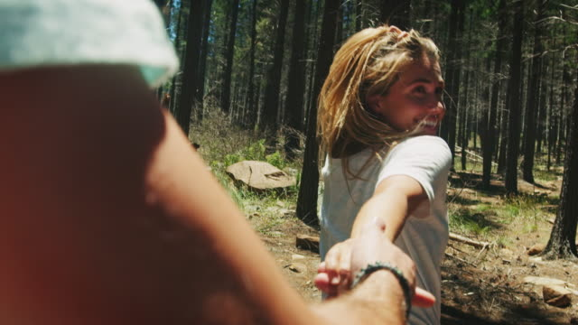 couple walking through forest - boyfriend stock videos & royalty-free footage