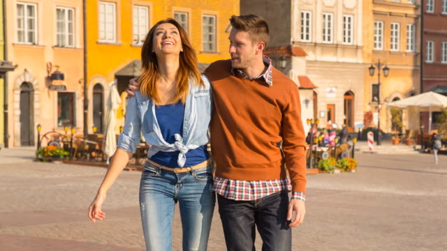 ms couple walking through historic city - warsaw stock videos & royalty-free footage