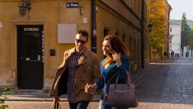 MS couple walking through historic city