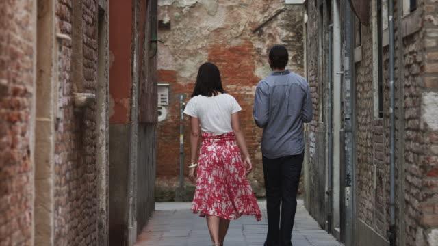 MS Couple walking through narrow old town streets / Venice,Veneto