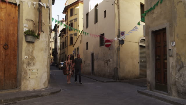 ms pan couple walking through old town streets / florence,tuscany - old town stock videos & royalty-free footage