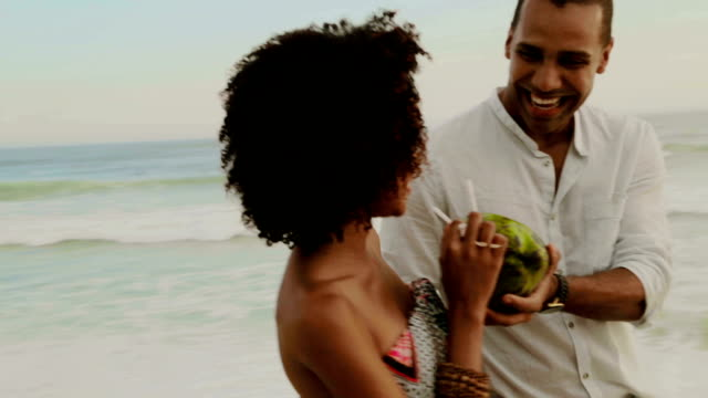 couple walking with coconut - rio de janeiro stock videos and b-roll footage