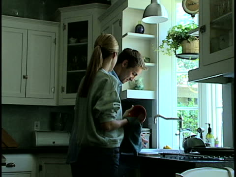 couple washing dishes - towel stock videos & royalty-free footage