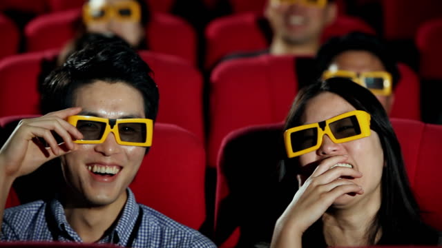 vídeos de stock, filmes e b-roll de cu couple watching and smiling in cinema / seoul, seoul, south korea - óculos de terceira dimensão