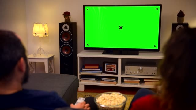 couple watching chroma key green screen tv at home - living room stock videos & royalty-free footage