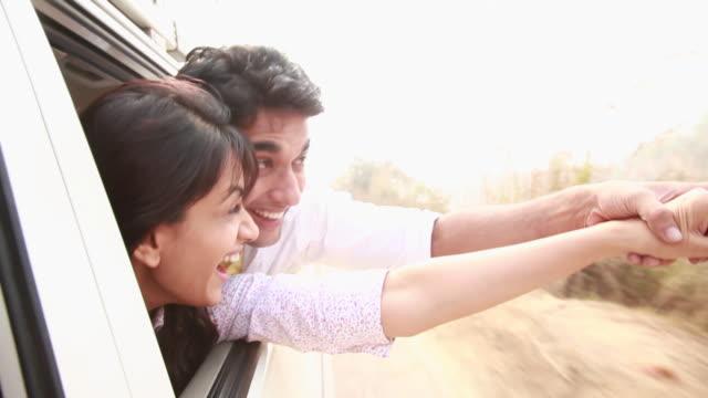 stockvideo's en b-roll-footage met couple watching from window of a car  - passagiersstoel