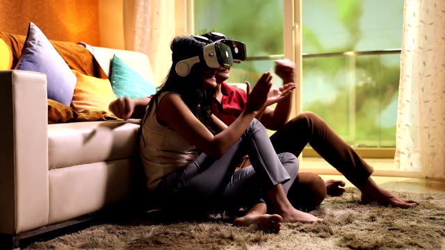 couple watching movie on virtual reality simulator, delhi, india - punching the air stock videos & royalty-free footage