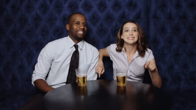 Couple Watching Sports in Bar