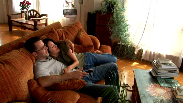 Couple watching sports of TV