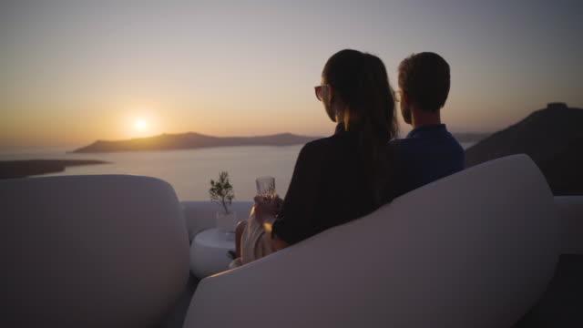 couple watching sunset in santorini