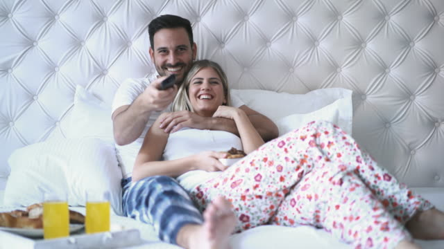 couple watching tv in bedroom. - time of day stock videos & royalty-free footage