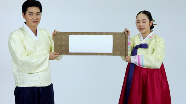 ms zo couple wearing hanbok holding blank folding screen / seoul, seoul, south korea - south korea couple stock videos & royalty-free footage