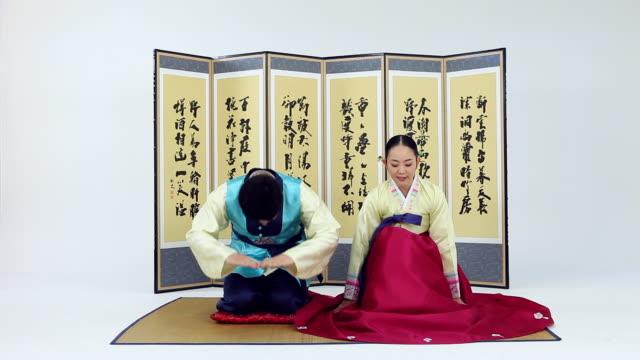 ms couple wearing hanbok is bowing / seoul, seoul, south korea - south korea couple stock videos & royalty-free footage