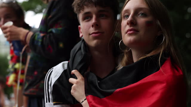 couple, who said they did not mind being photographed, reacting to the 2:0 goal for england outside in a beer garden on the uefa euro 2020 round of... - hygiene stock videos & royalty-free footage