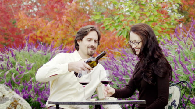 Couple wine tasting outside at winery