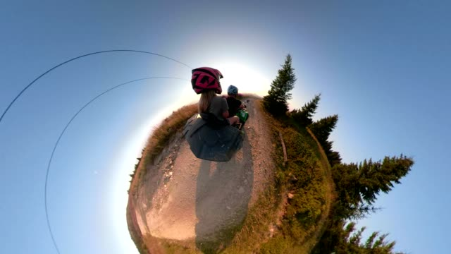 couple with a monopod riding on a quadbike in little planet format - quadbike stock videos & royalty-free footage