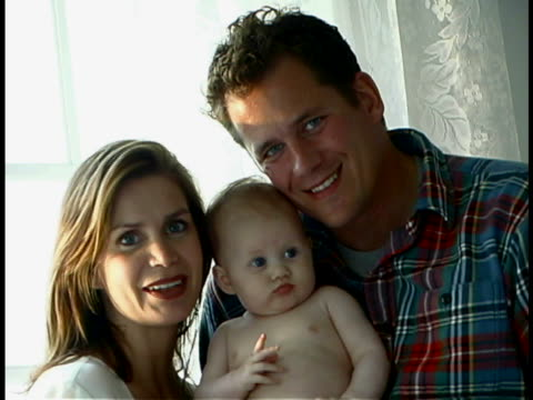 couple with baby - unknown gender stock videos & royalty-free footage