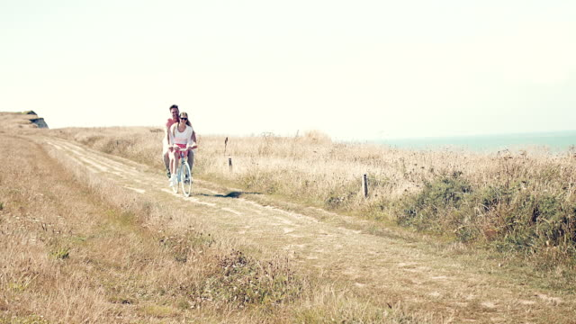 couple with bike - coastline stock videos & royalty-free footage