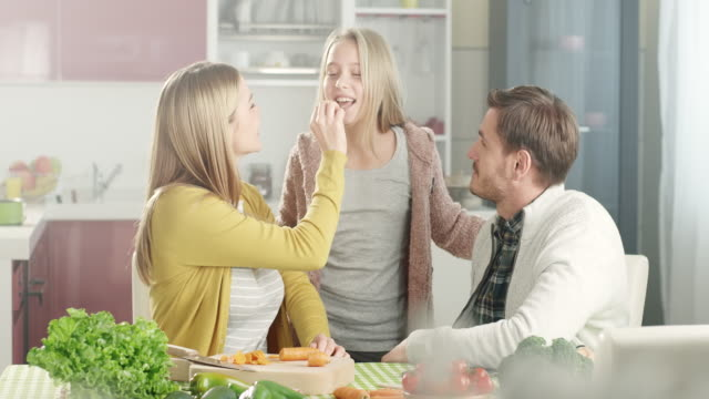 couple with daughter enjoying in the kitchen - happy meal stock videos and b-roll footage