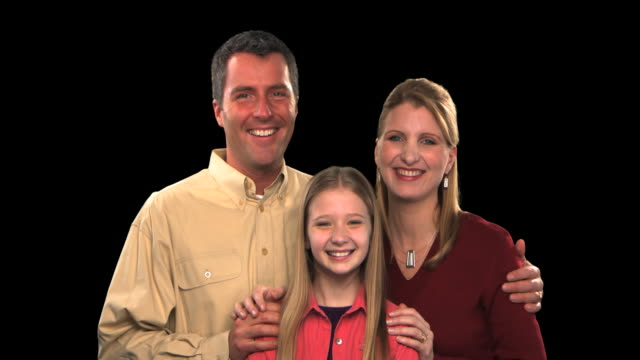 couple with daughter - this clip has an embedded alpha-channel - pre matted stock videos & royalty-free footage