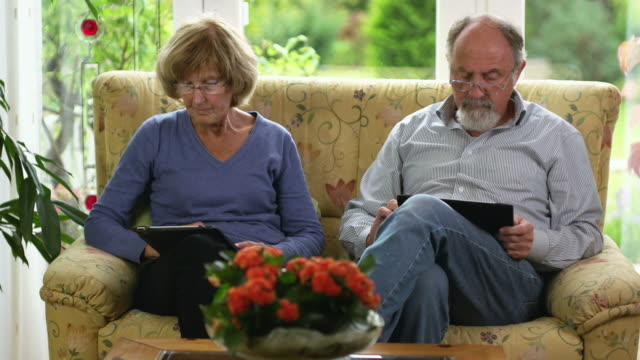 couple with digital tablet pcs - electronic book stock videos & royalty-free footage