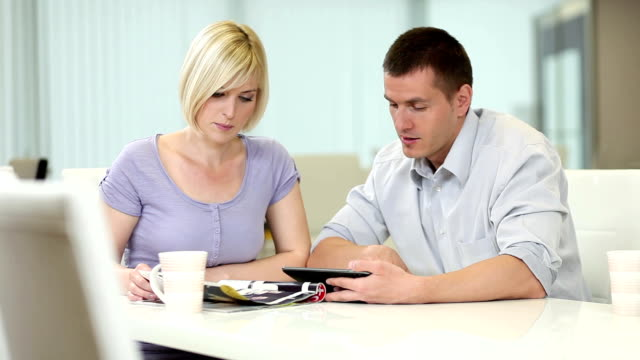 couple with digital tablet - magazine publication stock videos & royalty-free footage