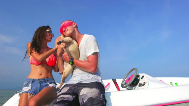 Couple with dog and boat 4K