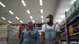 Couple with face mask walking and shopping in supermarket