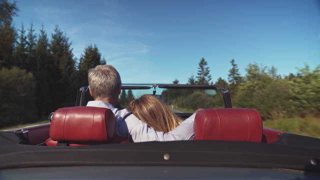 couple with hands raised traveling in vintage car - vintage car stock videos & royalty-free footage