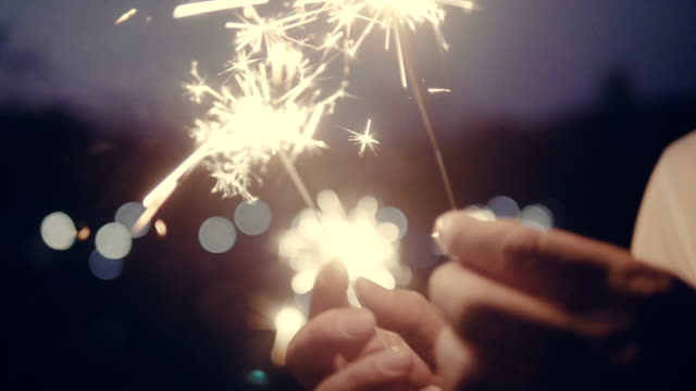 couple with sparklers - firework display stock videos & royalty-free footage