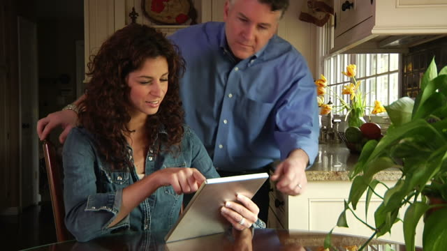 Couple with Tablet Computer