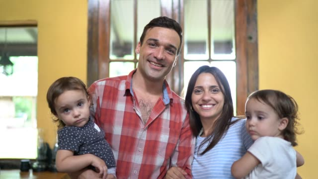 couple with two twins portrait at home - argentina stock videos & royalty-free footage