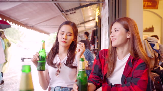 couple women sit happily drinking beer in a restaurant. - gift lounge stock videos & royalty-free footage