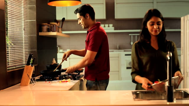 Couple working in the kitchen, Delhi, India