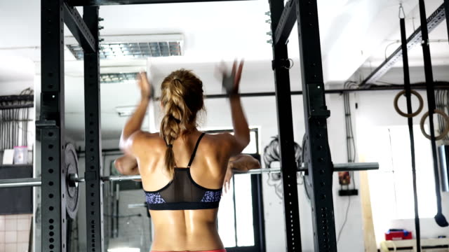 couple working out in gym - blonde hair stock videos & royalty-free footage