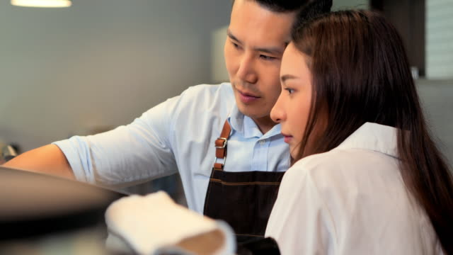 couple young asia barista feeling happy at the work day in the coffee shop.business,entrepreneur,small business,education,success concept - teaching stock videos & royalty-free footage