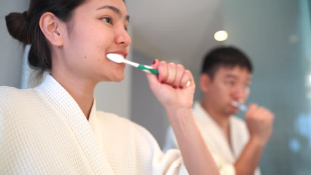 couples are brushing their teeth - toothpaste stock videos and b-roll footage