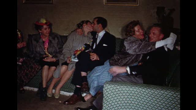 1960 ws pan couples celebrating new year's eve, toronto, ontario, canada - 1960 stock-videos und b-roll-filmmaterial