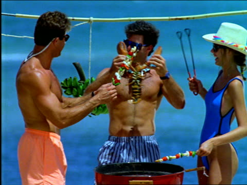 couples cooking on grill on beach - 1997 stock videos & royalty-free footage