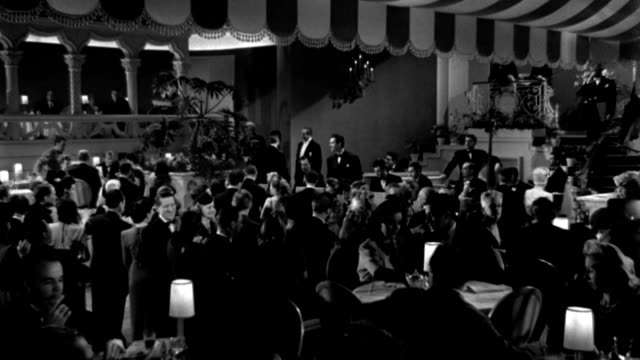 couples dance and dine as an orchestra plays in an elegant nightclub. - 1945 stock videos & royalty-free footage