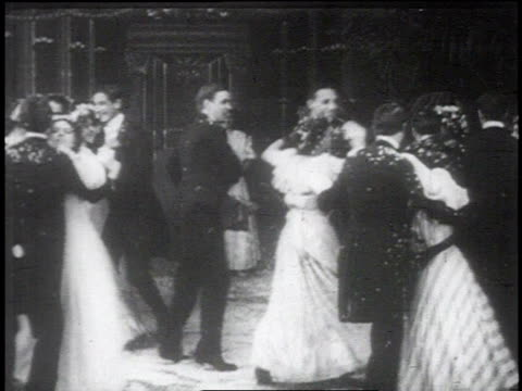1905 ws couples dancing and throwing confetti at each other / united states - history stock videos & royalty-free footage