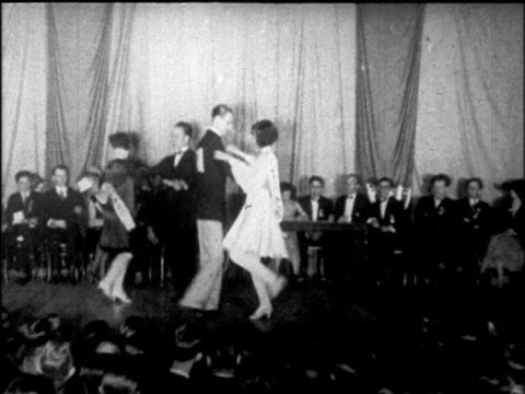 b/w 1925 couples dancing charleston at dance marathon / chicago / newsreel - 1925 stock videos & royalty-free footage