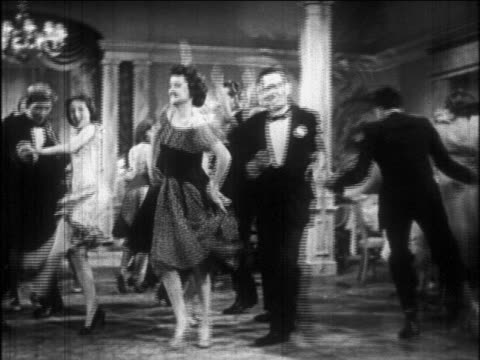 b/w 1926 couples dancing charleston excitedly / newsreel - 1920 stock-videos und b-roll-filmmaterial
