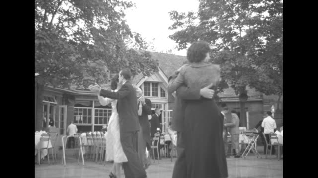 couples dancing, dining tables outside tavern on the green / bigger view, buildings in bg / dance floor, silhouette musicians in fg / boys by lake,... - draughts stock videos & royalty-free footage