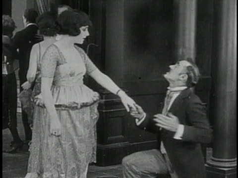 1920 montage couples dancing in ballroom and woman laughing off man's romantic gesture - romantic comedy stock videos and b-roll footage