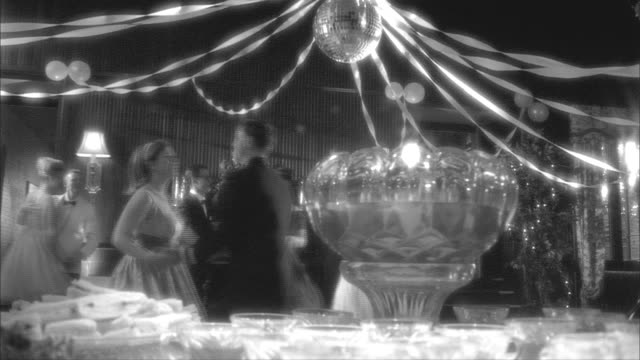 B/W, MS, PAN, Couples dancing in ballroom, table with cocktails in foreground, Rockford Woman's Club, Rockford, Illinois, USA