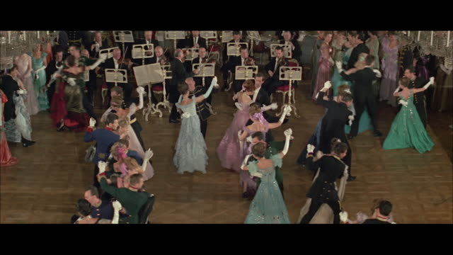 MS HA Couples dancing in ballroom to orchestra music